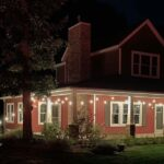farmhouse with lights